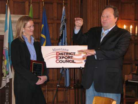 SRS Crisafulli, President, Laura M. Fleming, is shown receiving the award from Governor Schweitzer