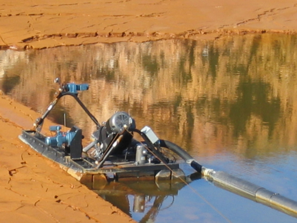 Rugged, versatile FLUMP can dredge & pump 80 cubic yards of solids per hour.