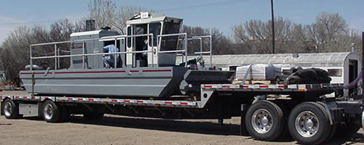 Portable, versatile Rotomite-6000 on lowboy for high speed transport by truck.