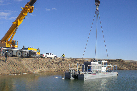 Rotomite 6000CD being put in lake by crane